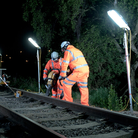 Vp Workers at night working on a rail